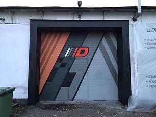 Логотип на воротах компании. Граффити на заказ.