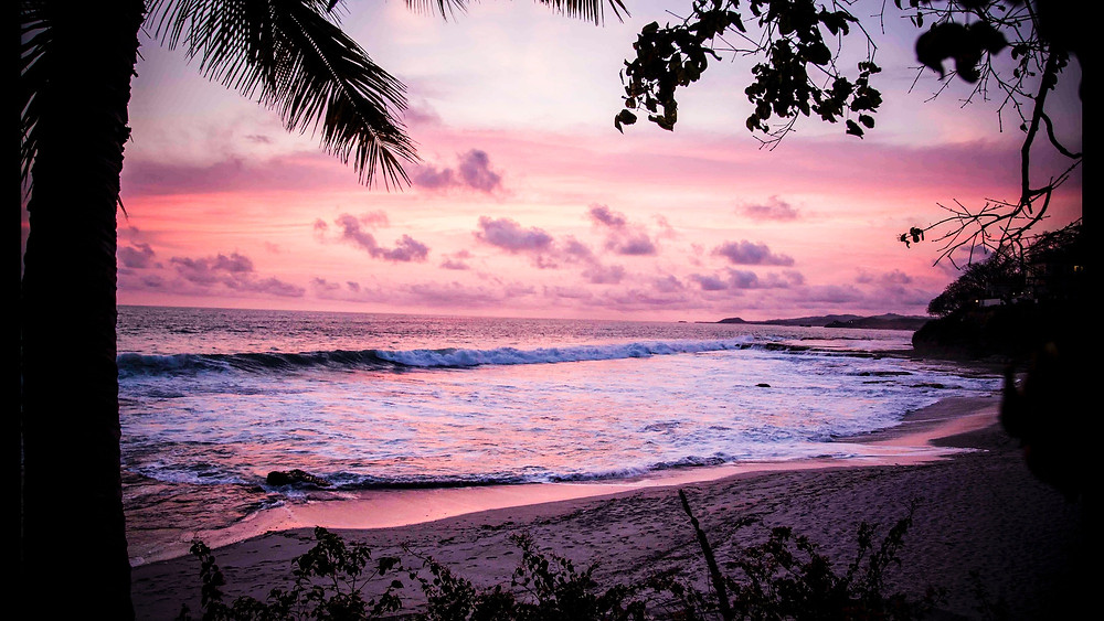 Beach in Nicaragua during a pink and purple sunset