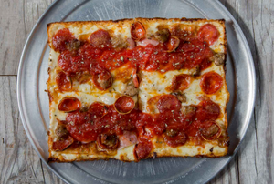 Square slices of deep-dish pepperoni pizza at Via 313 in Austin.