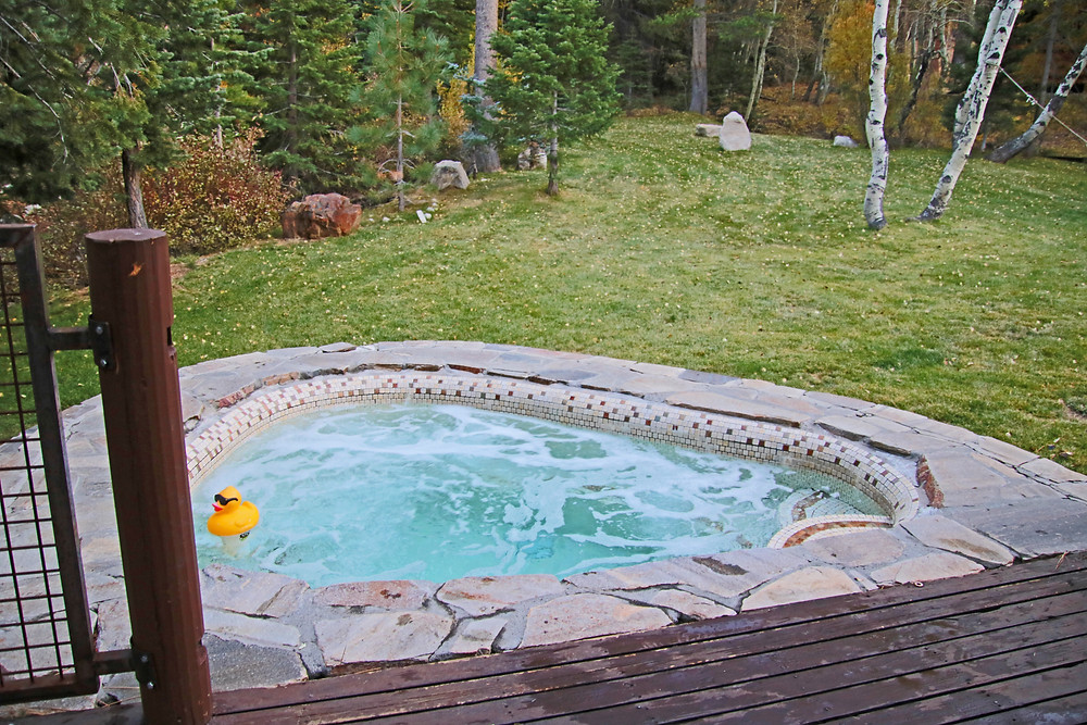 The outdoor hot tub that's built into the patio of the Yosemite Gateway Chalet in June Lake, California.