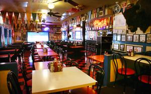 Diner-style interior of Hut's Hamburgers with sports memorabilia. mem