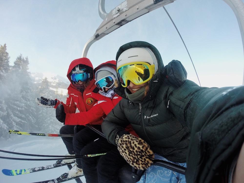 Women riding a ski lift during a women's ski clinic at Mammoth