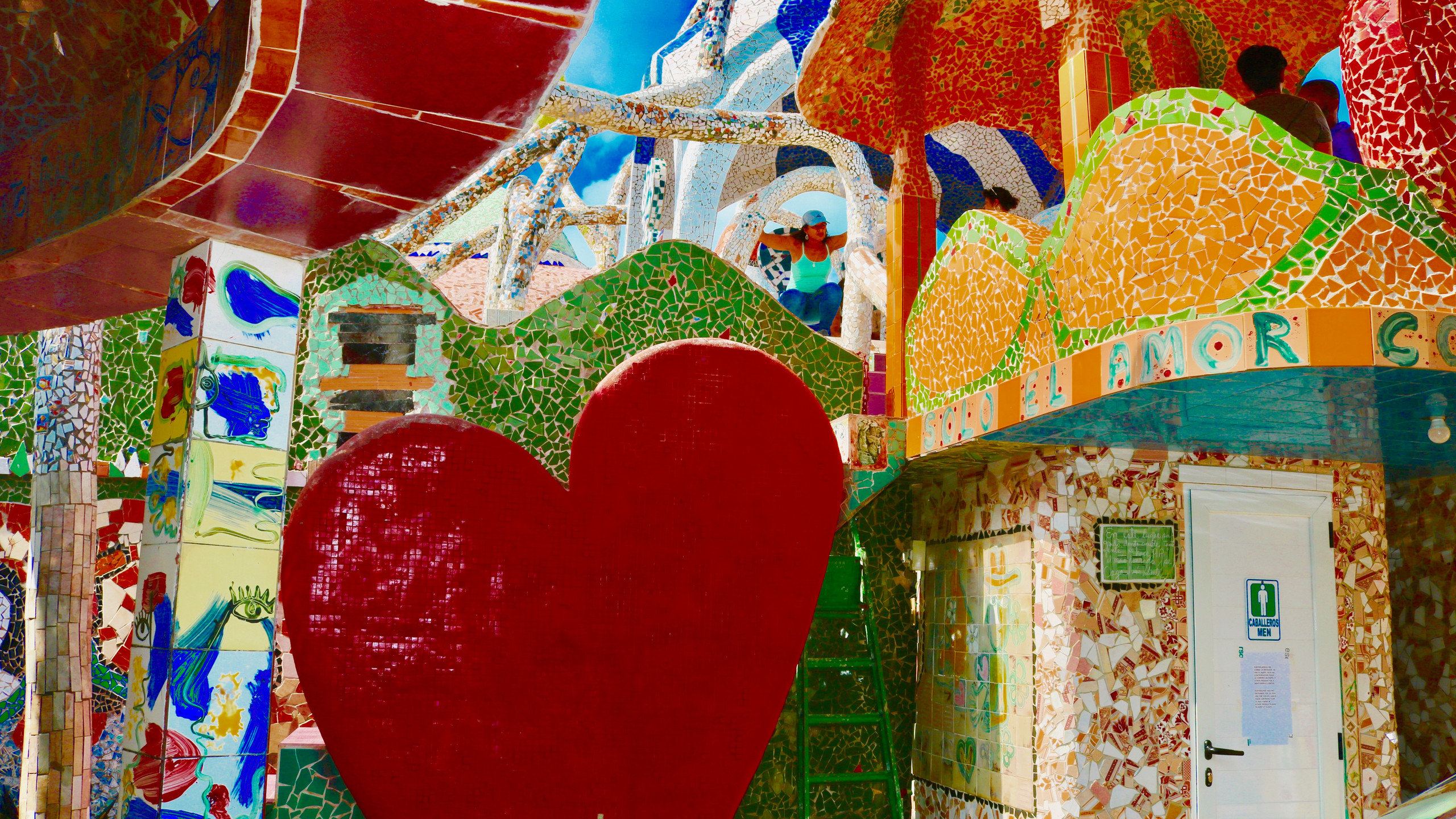 A large tiled heart and other shapes covered in colorful tiles at Fusterlandia.