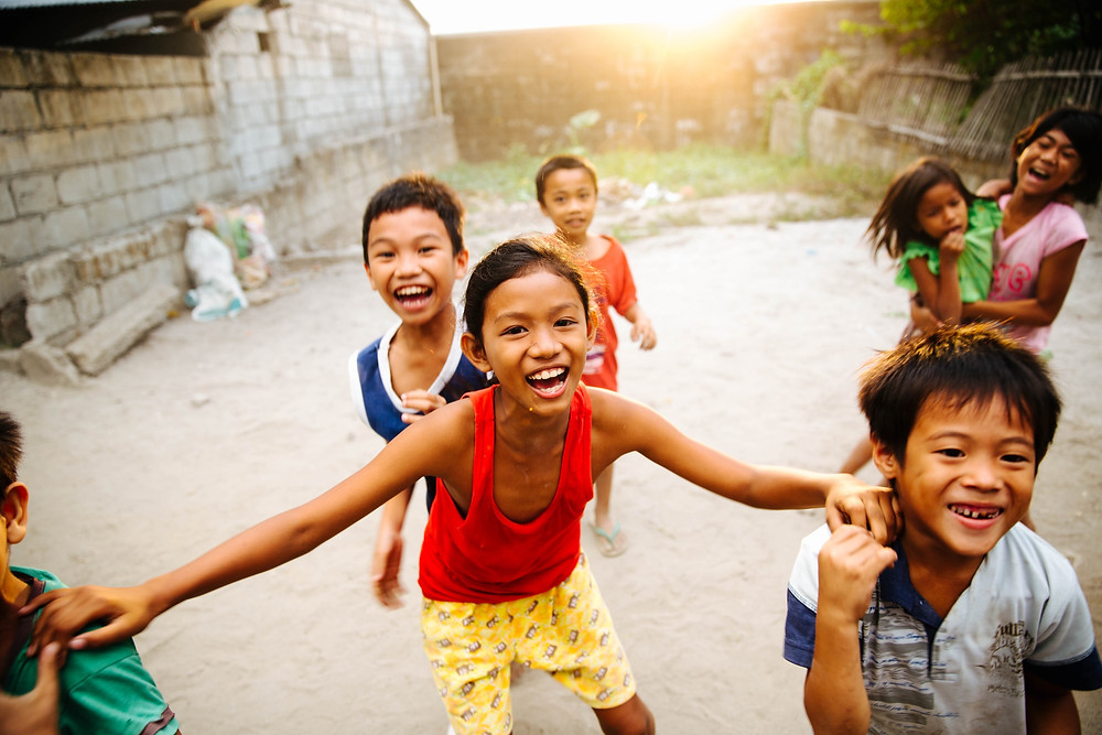 Laughing children in a rural village.