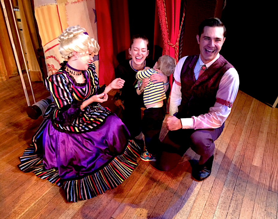 Characters at the Hoop Dee Doo Musical Revue at Disney world posing with a laughing mother and son