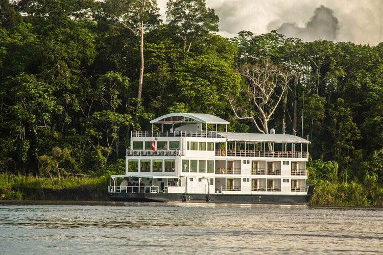 White riverboat on a family vacation cruise down the Peruvian Amazon.