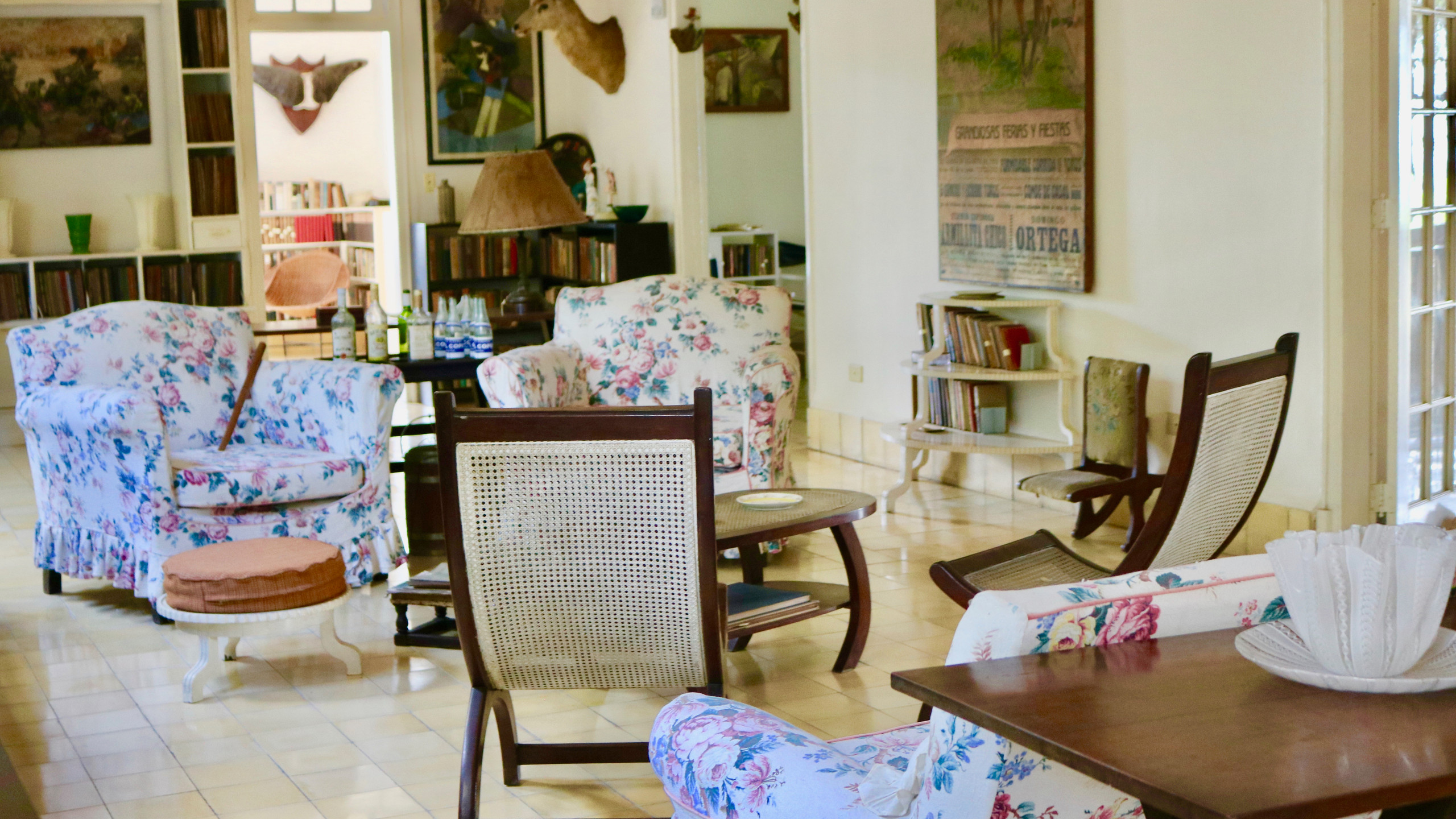 Living room with floral print furniture at Ernest Hemingway's Finca Vigia in Cuba.