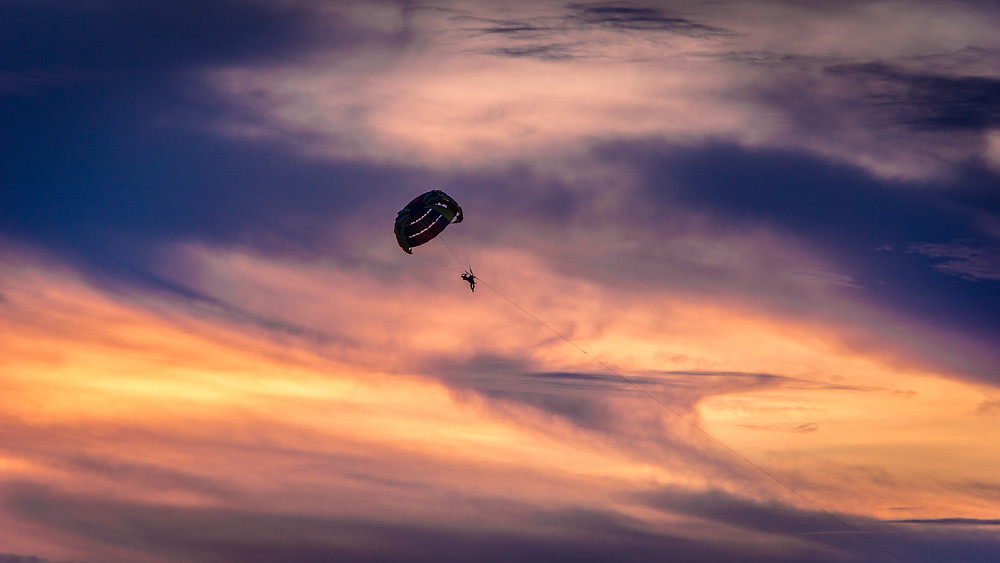 Parasailing at sunset during a Cabo San Lucas vacation