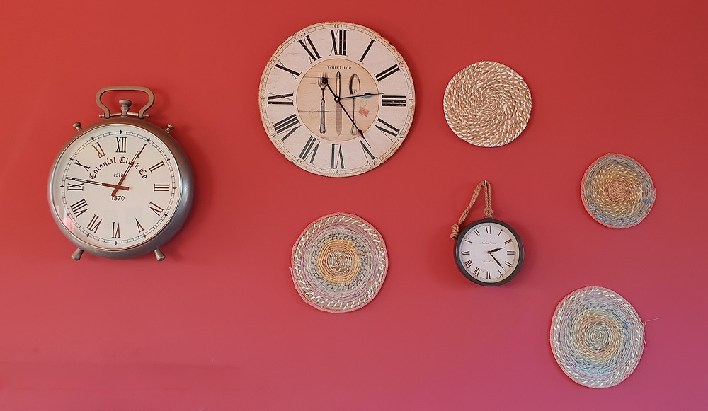 Clocks a red wall reminding people to pause before talking during an argument