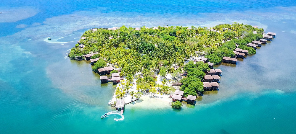 Aerial view of overwater cabanas on Roatan's Anthony's Key Resort.