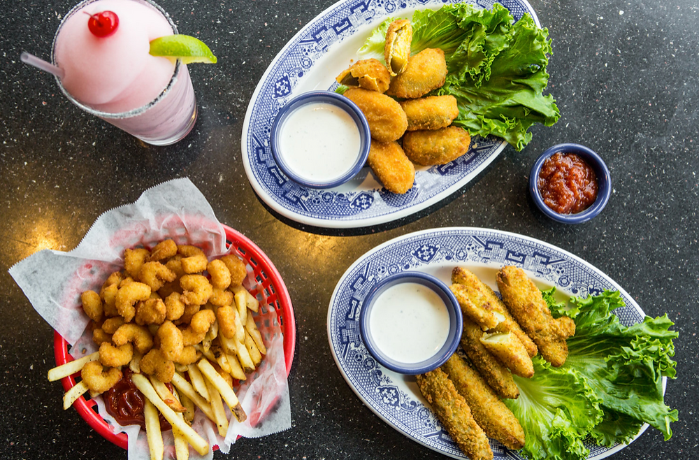 Popcorn shrimp and fries, fried pickles and a sorbet shake at Threadgill's