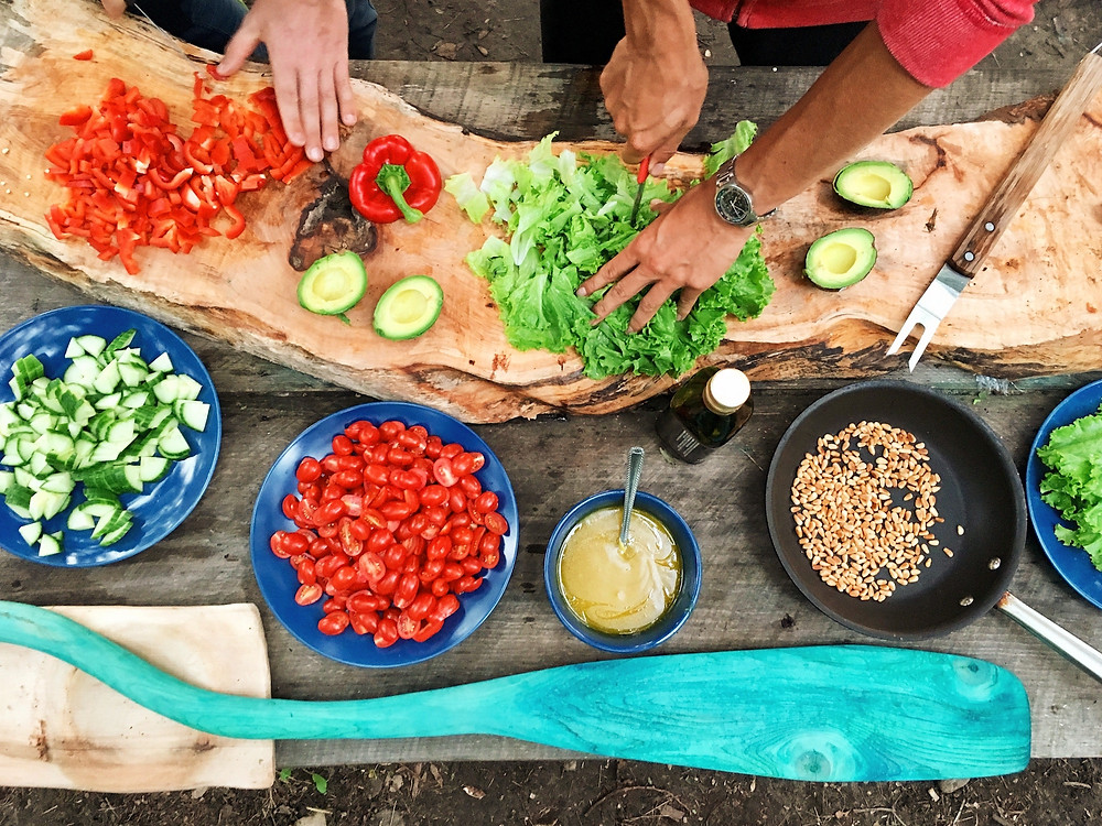 Table of vegetables and other ingredients being prepared for a meal in Nicaragua.