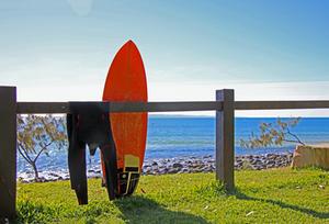 Surfboard and wetsuit at Sunshine Coast Australia
