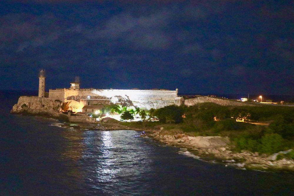 La Cabaña Fort in Havana, Cuba lit up at night.