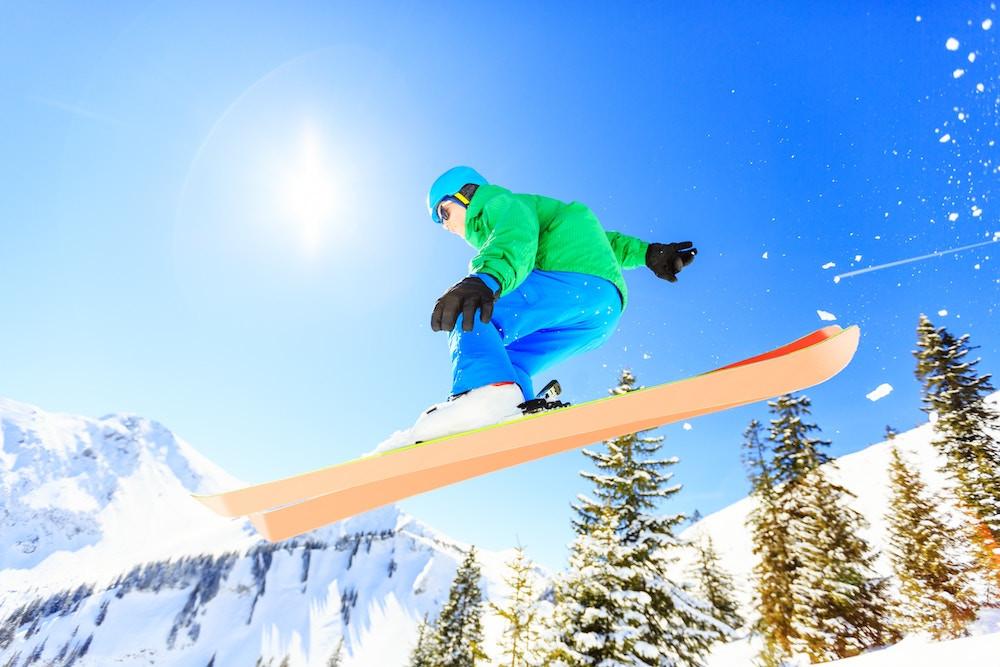 Backcountry skier doing a jump on Mammoth Mountain