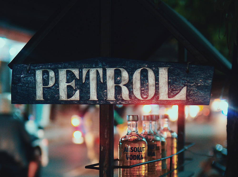 Black sign with petrol, the Australian term for gasoline