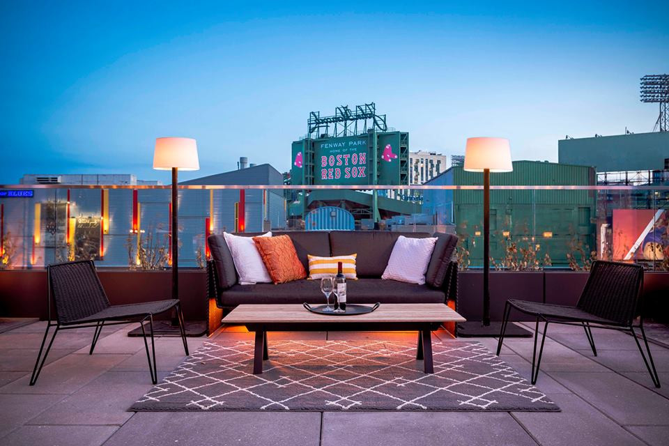 Furnished patio at Hotel Commonwealth overlooking Fenway Park
