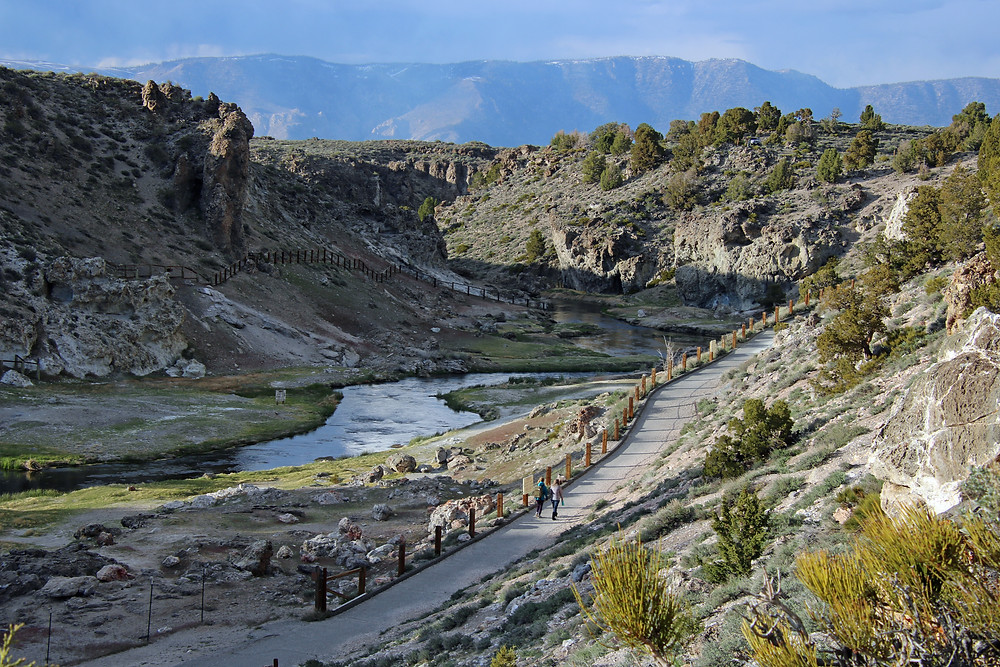 Two people hiking on the trail at Hot Springs, near Mammoth Lakes, California.