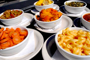 Mac and cheese, sweet potatoes, corn, okra, carrots and other sides at Hoover's Cooking in Austin.