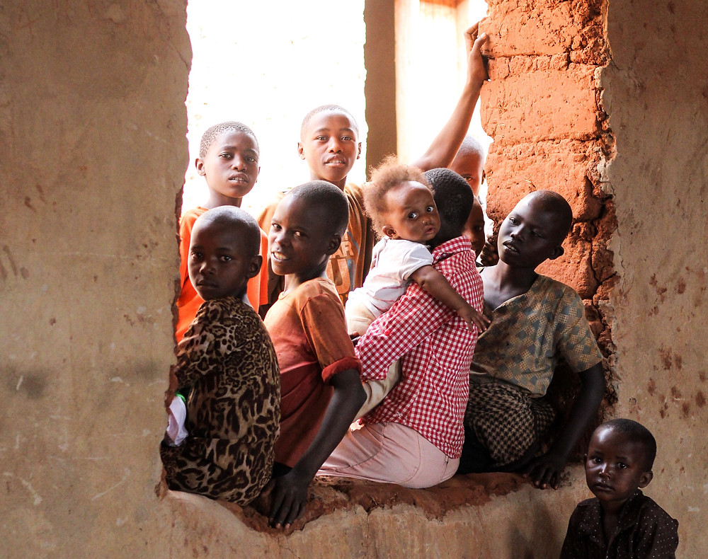 A group of children sitting in a window in Africa