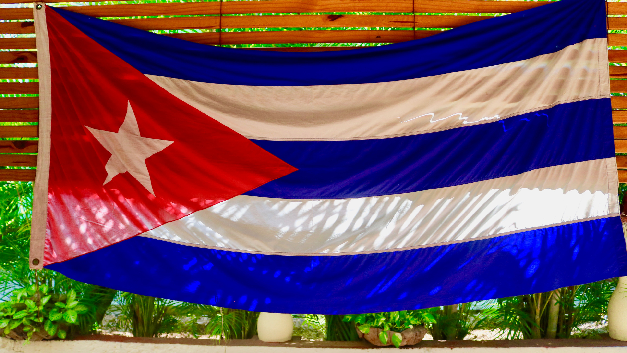 Cuban flag hanging in a restaurant in Havana.