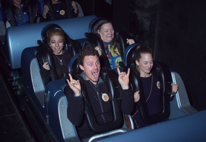 Four people riding the Rock 'n' Roller Coaster® Starring Aerosmith at Disney World