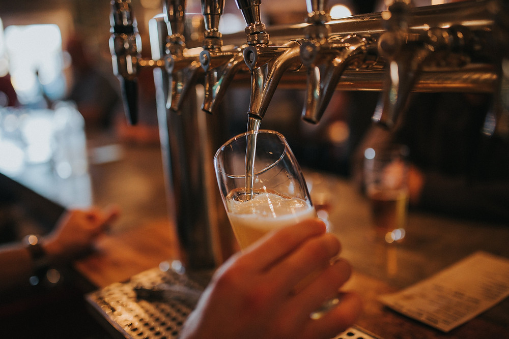 Beer being poured from tap at Lansdowne Street in Boston