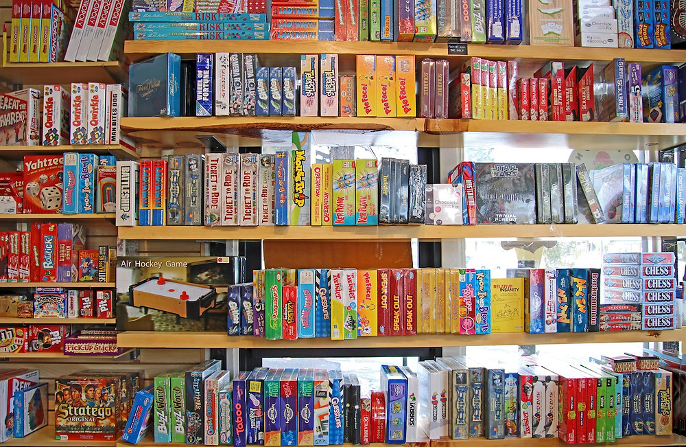 Colorful board games on the shelves at a toy store in Mammoth Mountain, California.