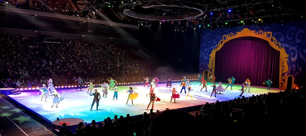 Disney characters dancing on ice during Disney on Ice performance