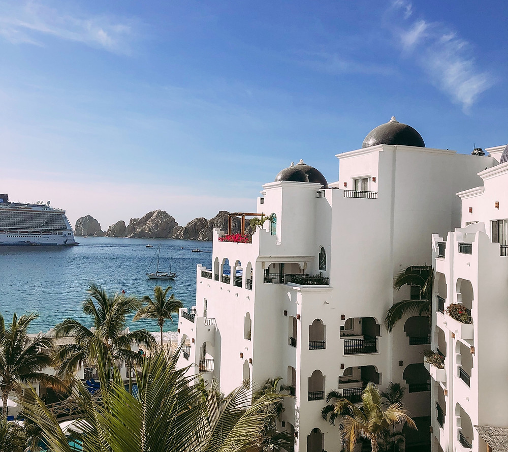 White hotel by the Cortez Sea and the Arches in Cabo San Lucas, Mexico