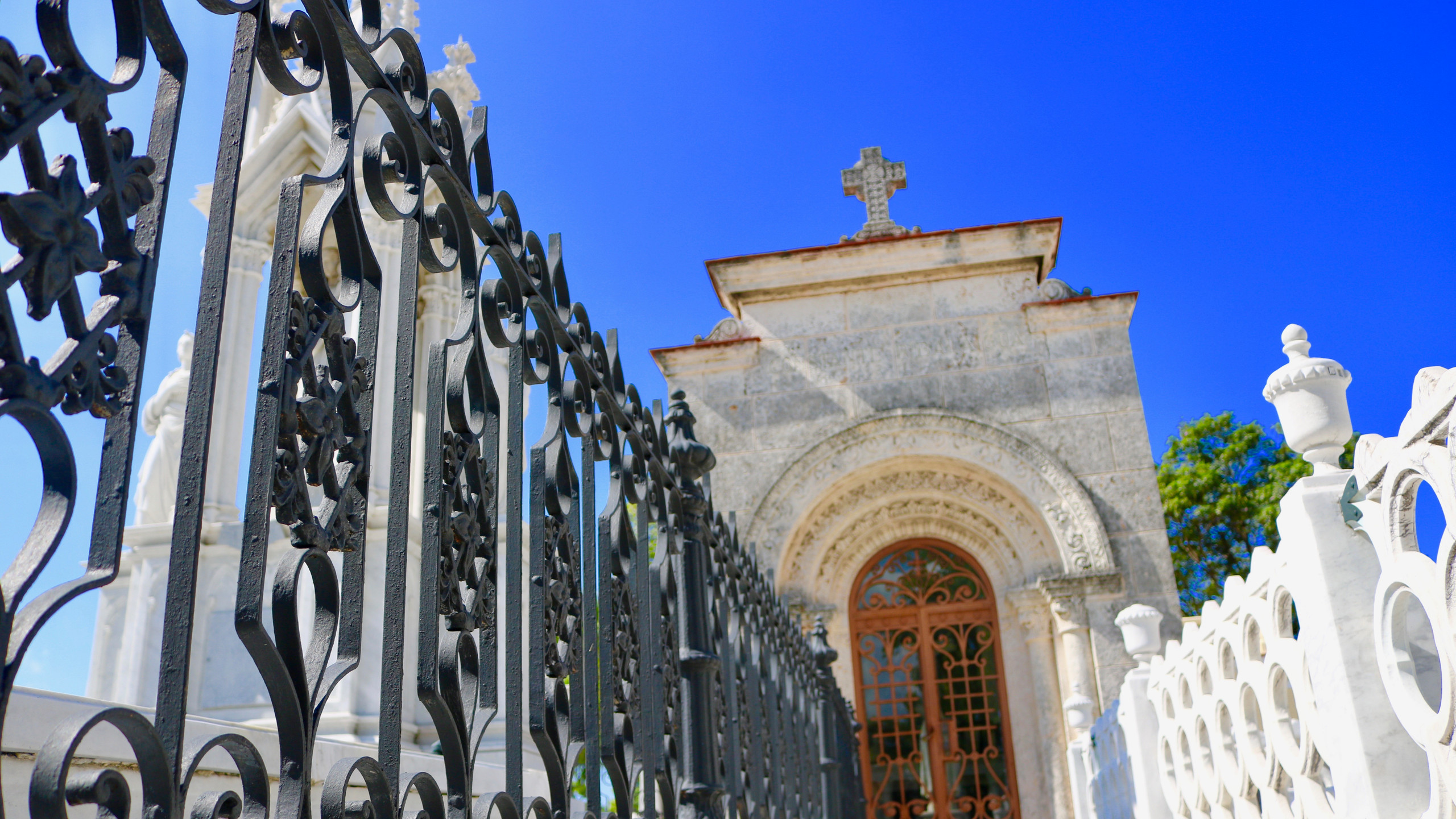Close-up of iron gate leading to a mausoleum in Cuba's Colon Cemetery.