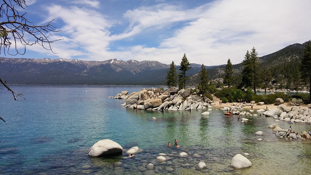 People enjoying summer activities at Sand Harbor on Lake Tahoe
