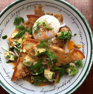 Plate with poached egg, toast and vegetables at Odd Duck in Austin.