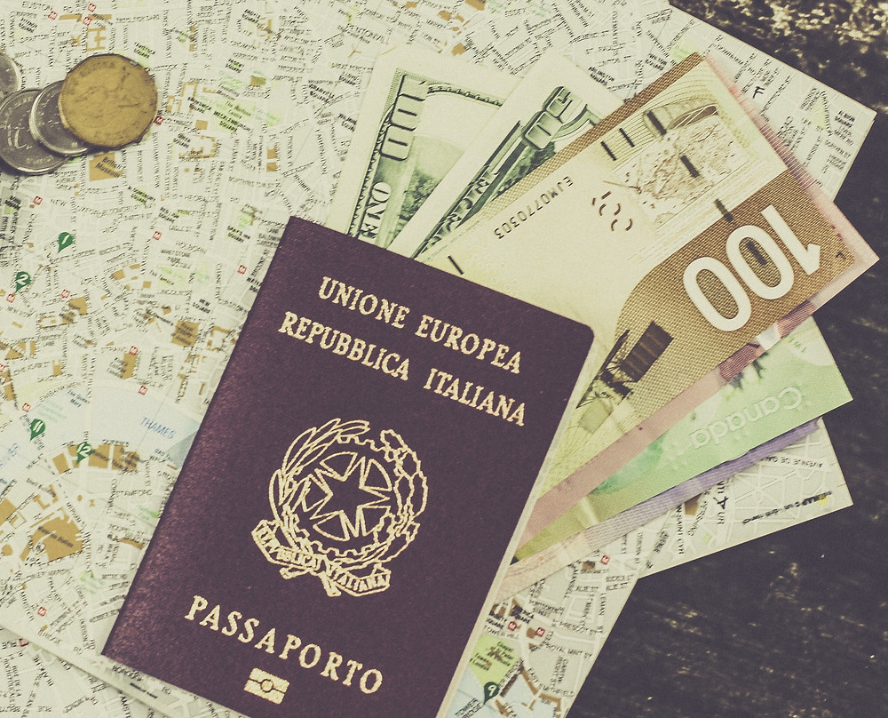 Map, passport and money that will be exchanged during a foreign holiday