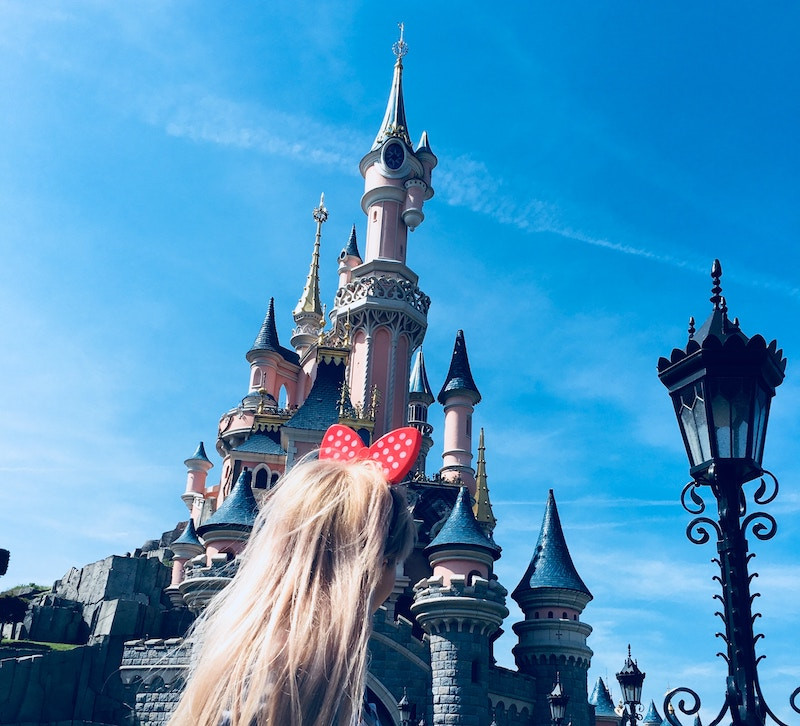 A blonde girl with Minnie Mouse ears she packed for a Disneyland vacation