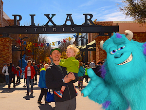 Father and son in front of Pixar Studios sign at Disney World