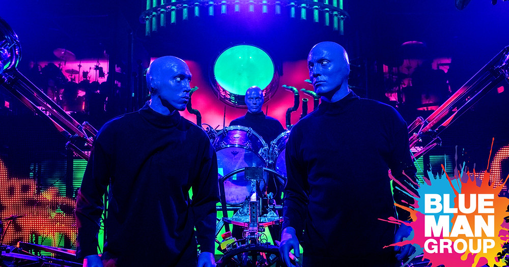 Three men painted blue from a Blue Man Group performance