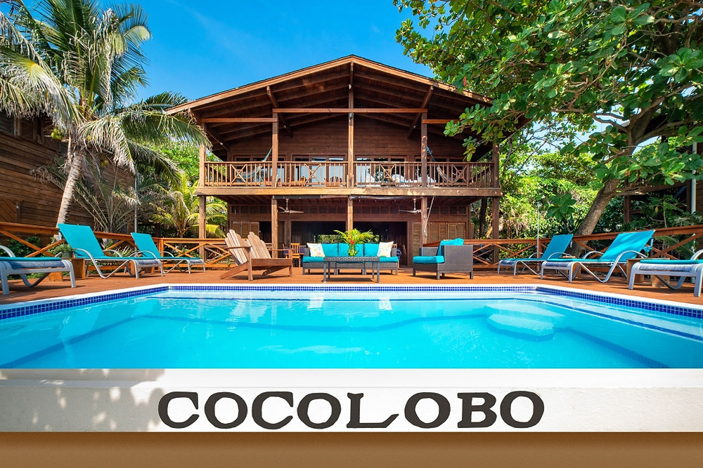 The pool and wooden exterior of the Cocolobo boutique hotel in Roatan, Honduras.