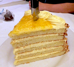 Giant piece of yellow cake at The Boat House in Disney Springs
