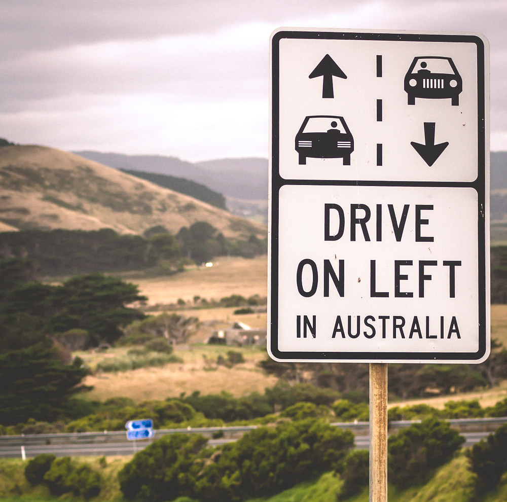 Australian sign reminding people to drive on left side of road