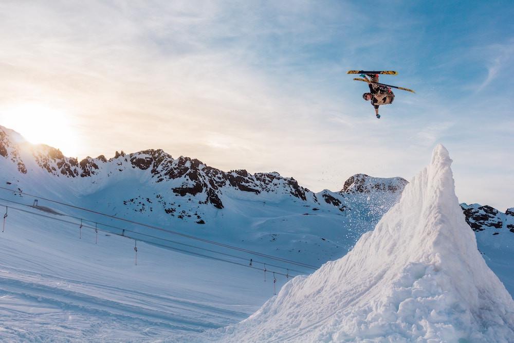 Skier doing a jump during a terrain park clinic at Mammoth Mountain