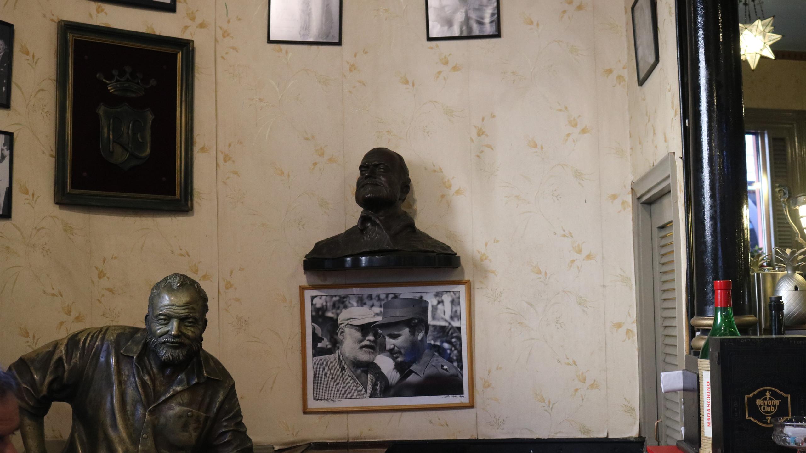 Statue of Ernest Hemingway sitting at the bar in Havana's El Floridita.