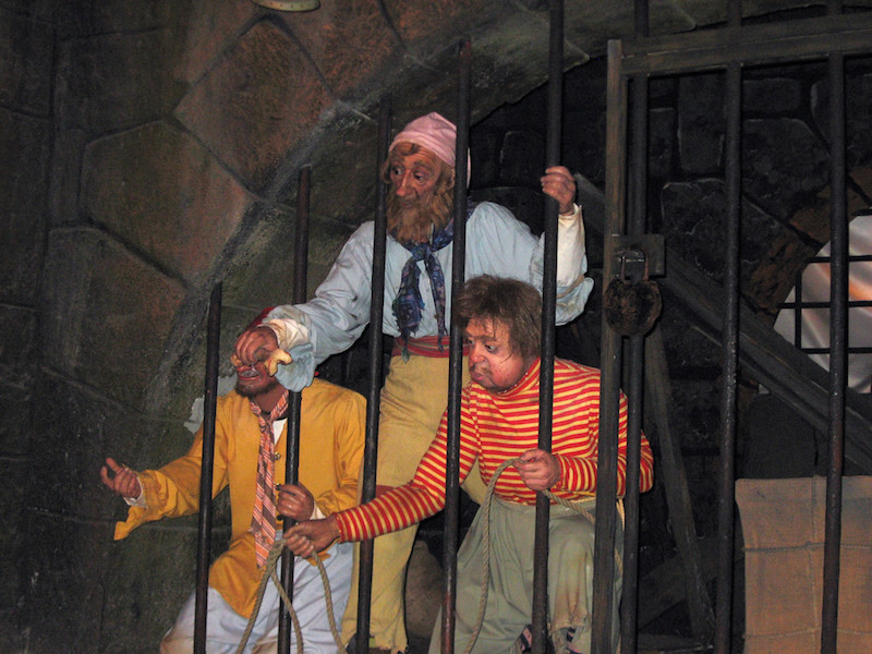 Three pirates in jail on the Pirates of the Caribbean ride at Disney World