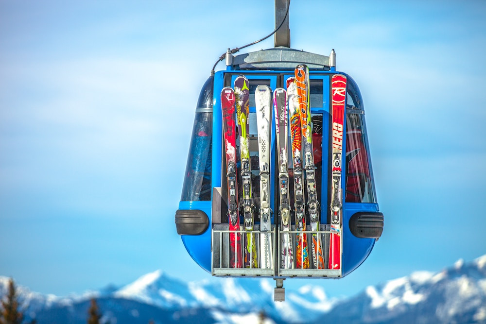 Ski gear on a mountain gondola during a winter family vacation