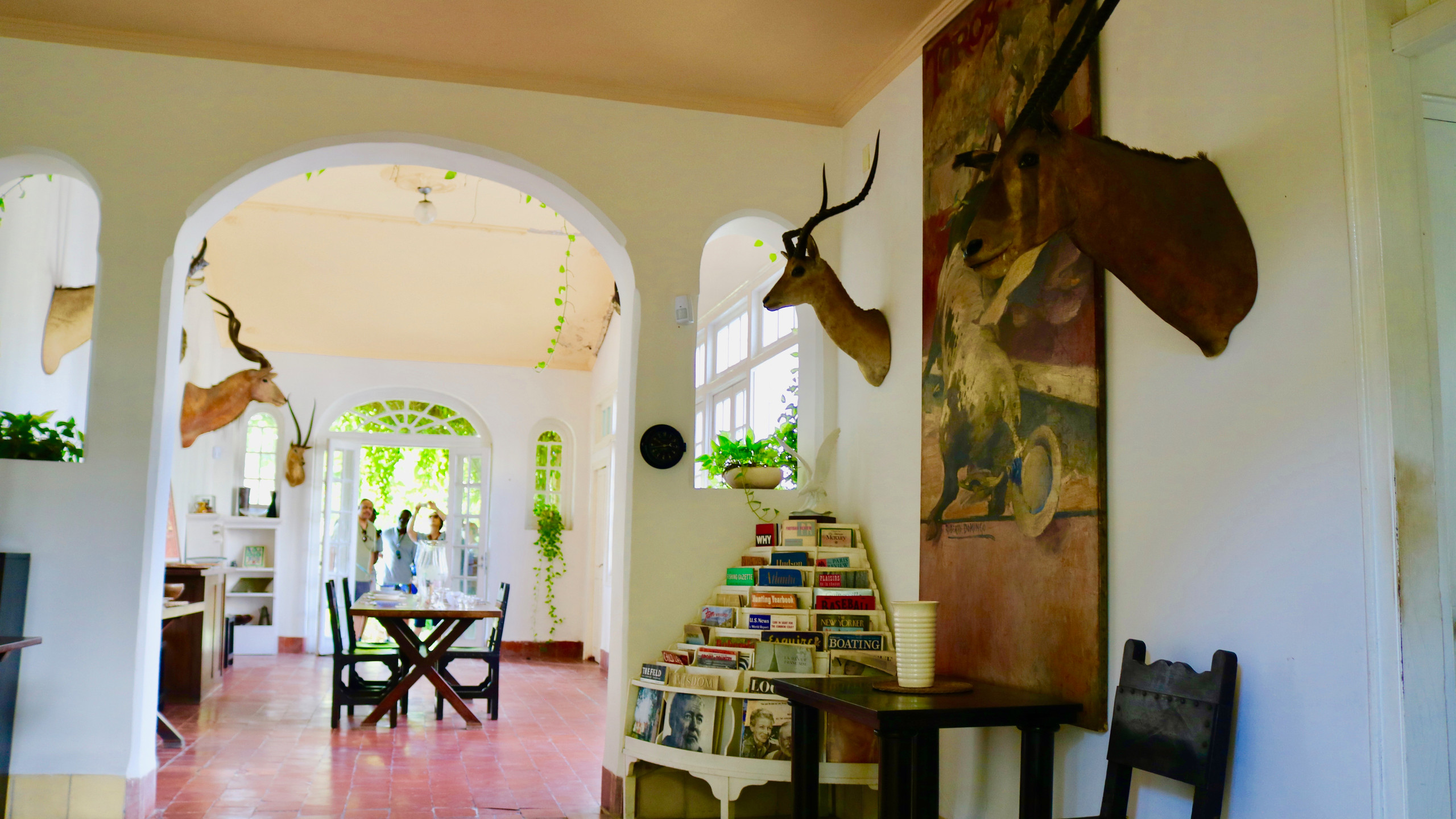 Dining room and walls with antelope heads at Ernest Hemingway's Finca Vigia home.