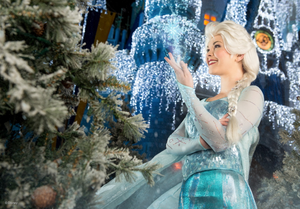 Elsa standing in front of a frosted castle during For the First Time in Forever: A Frozen Sing-Along Celebration at Disney World