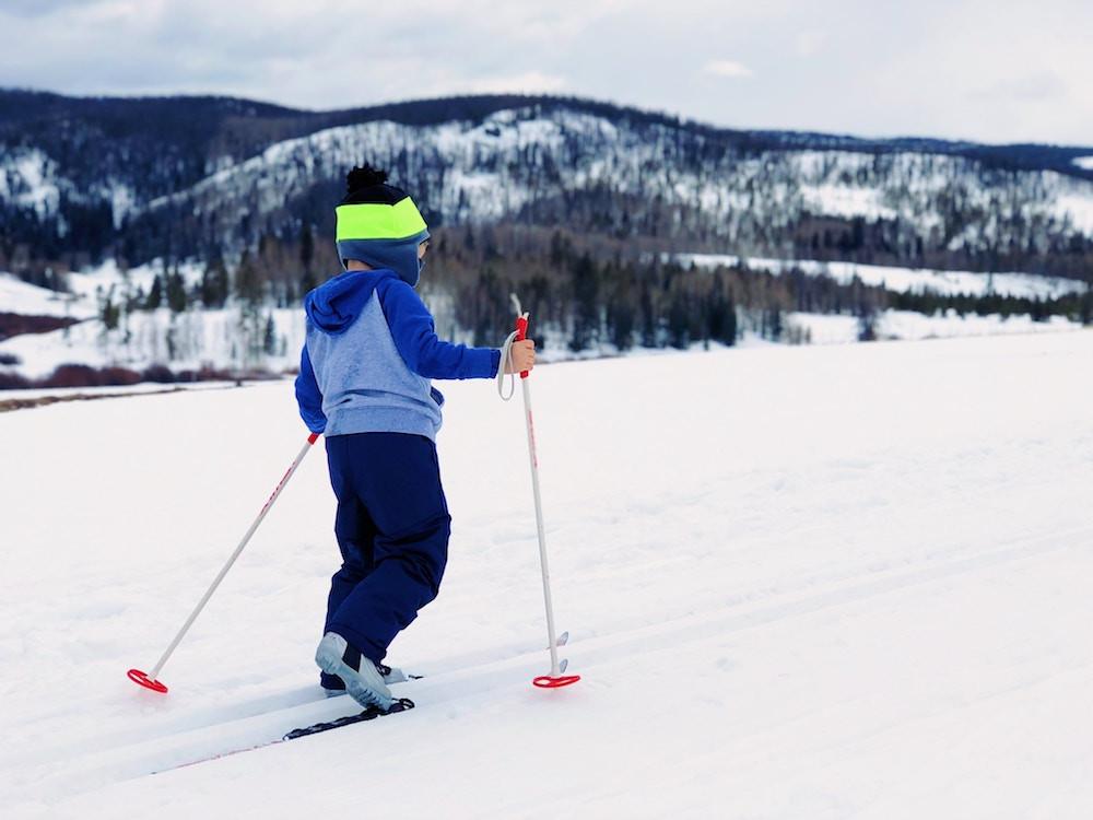 Child on skis at a Mammoth Mountain kid ski lesson