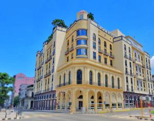 Light yellow exterior of Iberostar Parque Central hotel in Havana, Cuba.
