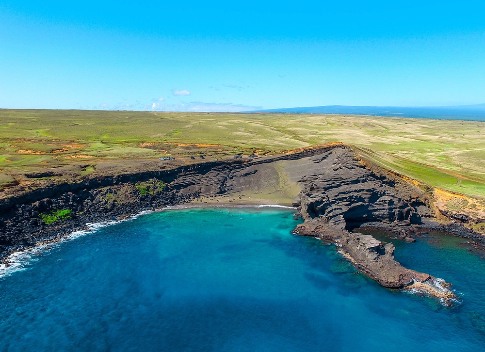 Aerial view of the green sand and clear water at Green Sand (Papakolea) Beach – Big Island