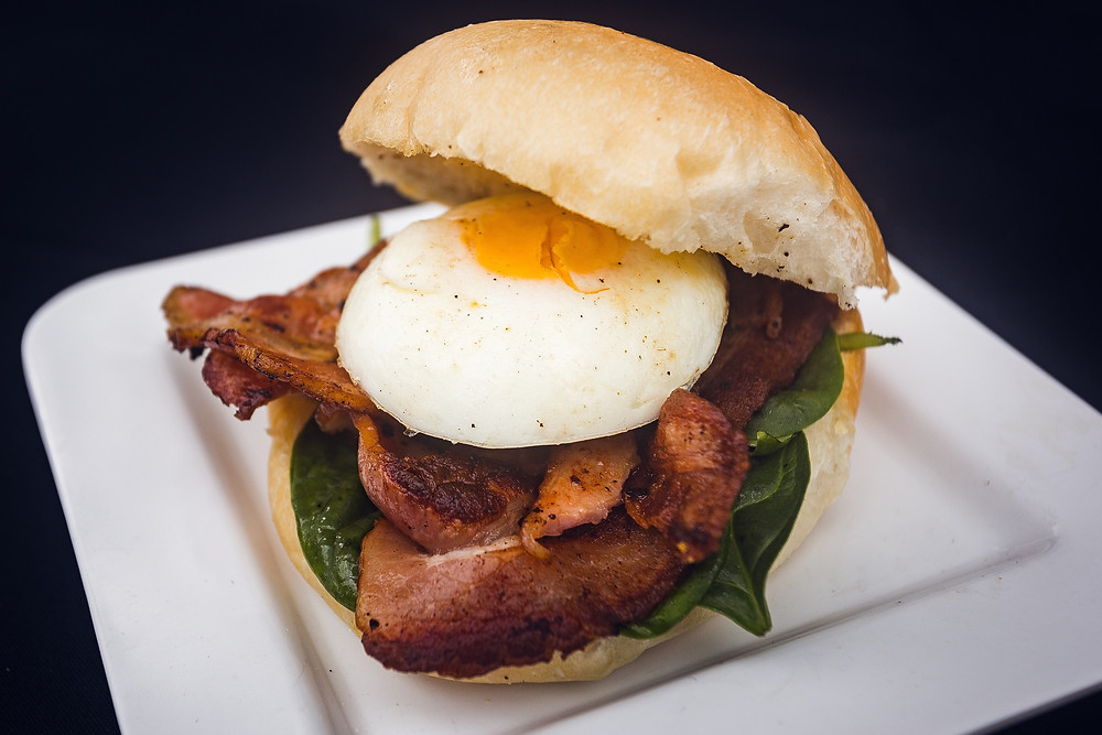 Australian breakfast sandwich with fried eggs and bacon
